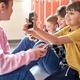 School children sitting on the floor and using smartphone - PhotoDune Item for Sale