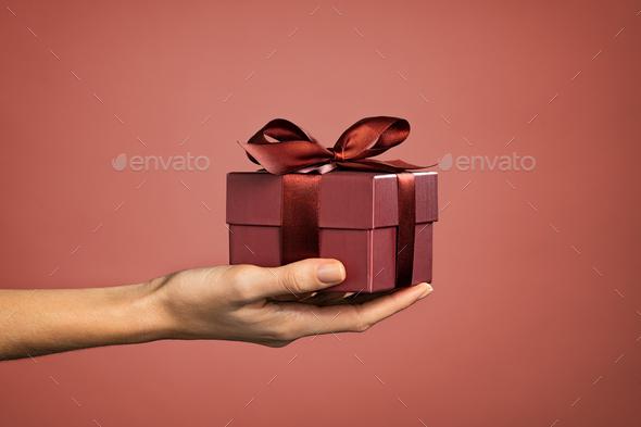 Woman hand holding elegant gift box - Stock Photo - Images