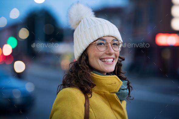 Happy winter woman on urban street - Stock Photo - Images