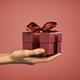 Woman hand holding elegant gift box - PhotoDune Item for Sale