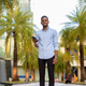 Full length shot of handsome black African businessman outdoors in city during summer smiling and - PhotoDune Item for Sale