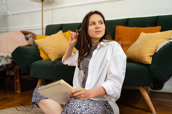 Woman writing and making notes to her diary - Stock Photo - Images