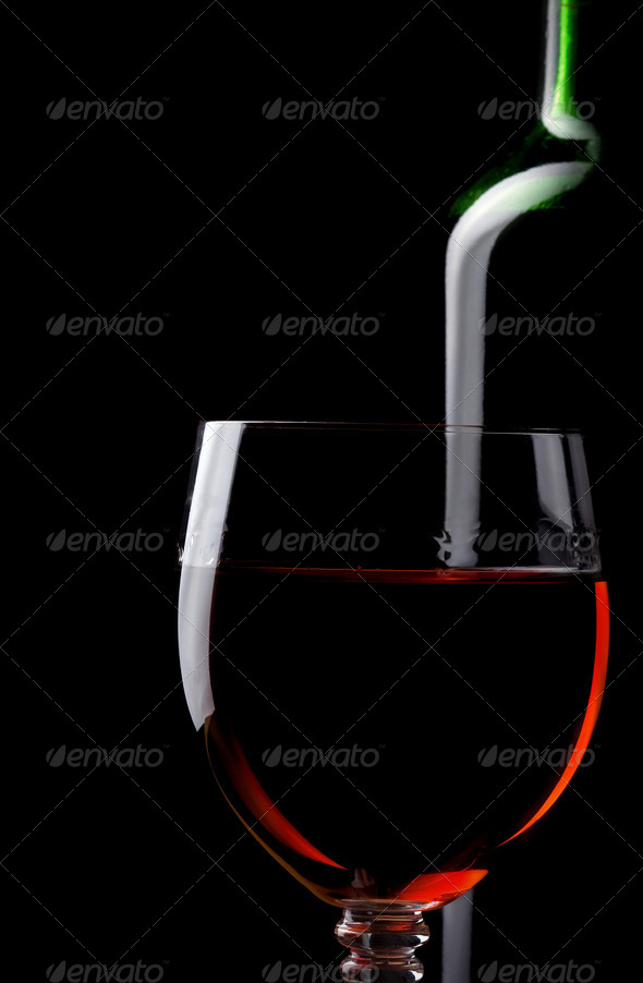 red wine in glass and bottle isolated on black - Stock Photo - Images
