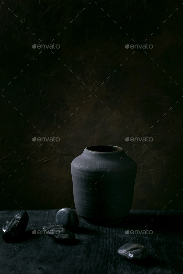 Black ceramic vase on black wooden table - Stock Photo - Images