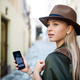 Young woman traveler in city on holiday using smartphone, sightseeing - PhotoDune Item for Sale