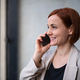 Portrait of mid adult businesswoman standing indoors in office, using smarpthone - PhotoDune Item for Sale