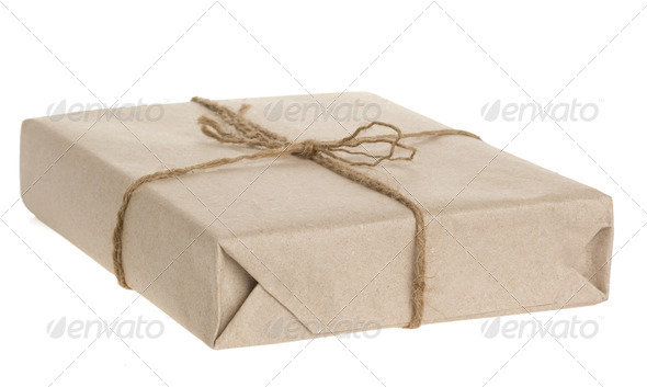 parcel wrapped tied with rope isolated on white - Stock Photo - Images