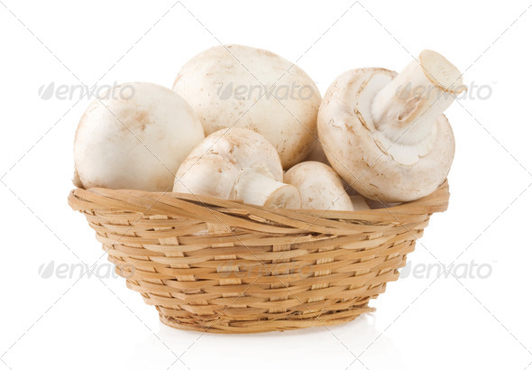 mushrooms in wicker basket isolated on white - Stock Photo - Images