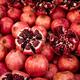 Cracked pomegranate. Ripe pomegranate close-up - PhotoDune Item for Sale