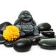 Buddha and stack of black basalt stones - PhotoDune Item for Sale