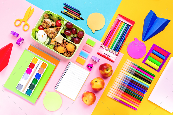 Back to school flat lay with supplies and lunchbox - Stock Photo - Images