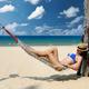 Woman in hammock on beach - PhotoDune Item for Sale