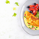 Keto breakfast. Omelette with cheese, tomatoes and green onions on light table. - PhotoDune Item for Sale