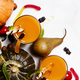 Halloween background with pumpkin juice, disgusting worms and black sweets, top view - PhotoDune Item for Sale