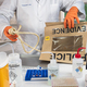 Police scientist extracts rope from hanging victim, crime lab analysis, conceptual image - PhotoDune Item for Sale