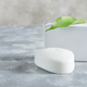 White soap for hand with leaf at stone background. Mock up for logo and text - PhotoDune Item for Sale