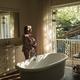 Senior caucasian woman running a bath in bathroom - PhotoDune Item for Sale