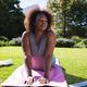 African american woman exercising on yoga mat in sunny garden - PhotoDune Item for Sale