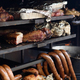 A large grill is used to cook different types of meat and vegetables. Street Food Festival. - PhotoDune Item for Sale