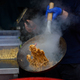 A chef prepares Chinese food at a street food festival. - PhotoDune Item for Sale