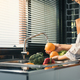 Asian hands woman washing fruit orange and preparation healthy food in kitchen. - PhotoDune Item for Sale