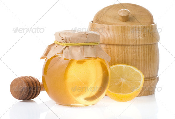 jar of honey and lemon isolated on white - Stock Photo - Images