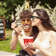 Happy attractive young couple romantically eating a fresh pizza outdoors - PhotoDune Item for Sale
