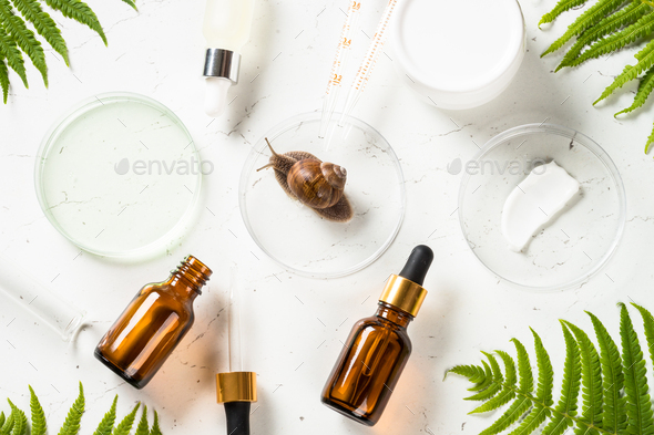 Snail mucin products at white background. Natural cosmetic - Stock Photo - Images