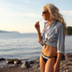 Beautiful Blonde Young Woman Eating Flavored Ice At Beach - PhotoDune Item for Sale