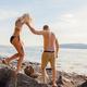 Man Holding Hand Helping Girlfriend On Rocks - PhotoDune Item for Sale