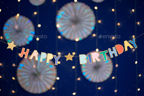 Happy birthday garland and decorations on blue background - Stock Photo - Images