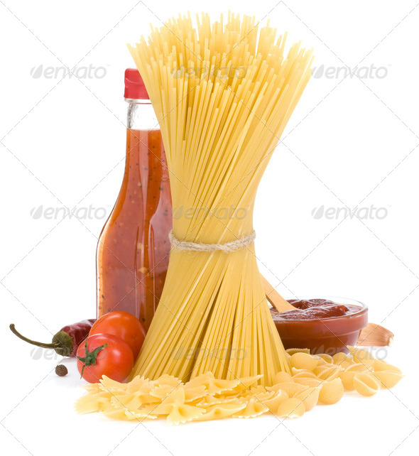 uncooked raw pasta and food spices - Stock Photo - Images