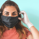 Mature Latin woman portrait wearing protective face mask and gloves - PhotoDune Item for Sale