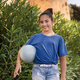 Smiling girl kid wearing t-shirt and jeans stays with a ball - PhotoDune Item for Sale
