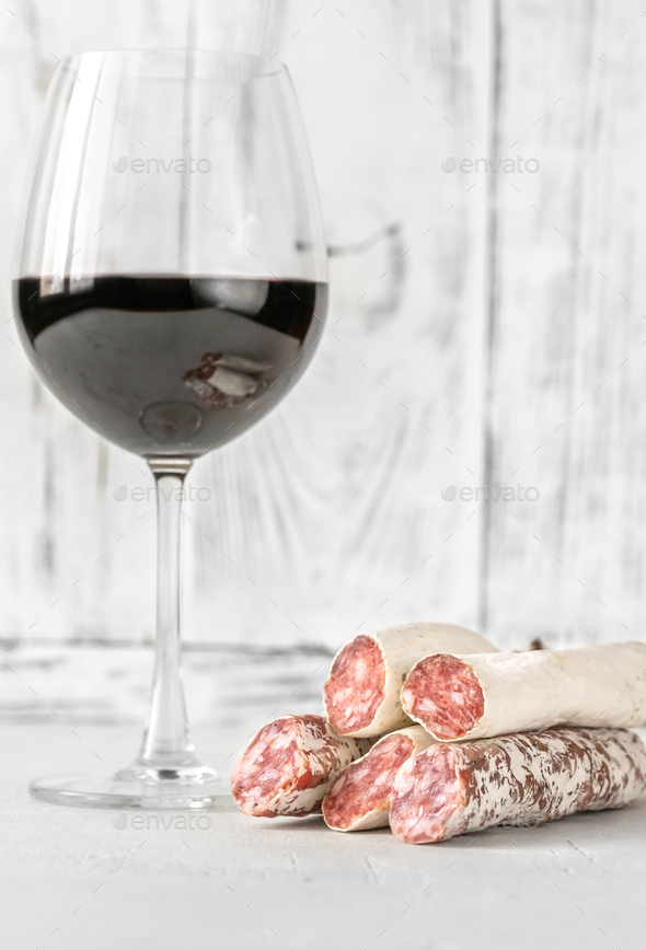 Glass of wine with fuet - Stock Photo - Images