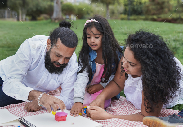 Happy indian family having playful time at park - Concept of family love - Stock Photo - Images