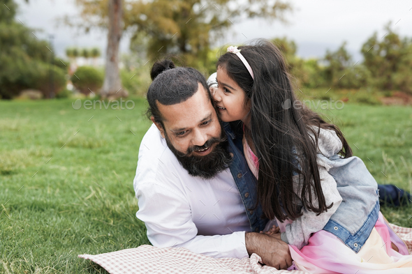 Indian father enjoy pic nic with daughter at city park - Stock Photo - Images