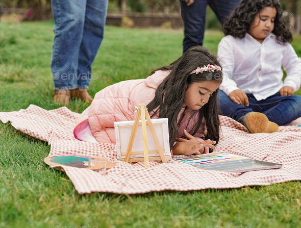 Happy indian family enjoy day at city park - Family, parents and children love - Stock Photo - Images