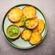 Tasty Brinjal Pakora or crispy eggplant fritters, Indian tea time snack served with green chutney - PhotoDune Item for Sale