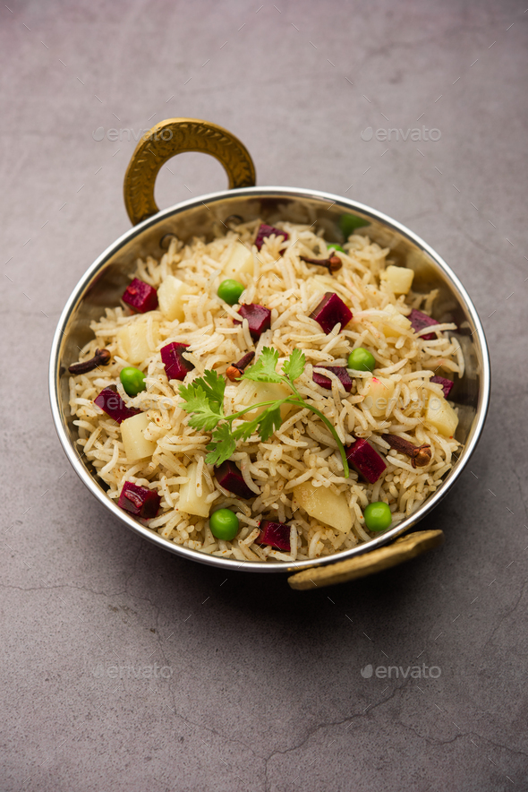 Beetroot Rice or pulao or pulav served in a bowl or karahi, selective focus. Indian food - Stock Photo - Images