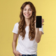 This app all you need. Cheerful friendly outgoing stylish girl showing her smartphone blank mobile - PhotoDune Item for Sale