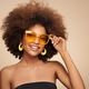 Beauty portrait of African American girl in sunglasses - PhotoDune Item for Sale