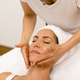 Middle-aged woman having a head massage in a beauty salon - PhotoDune Item for Sale