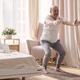 Senior hispanic man practicing yoga at home doing Chair pose, Utkatasana - PhotoDune Item for Sale