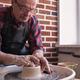 Senior male potter creating bowl in pottery workshop. - PhotoDune Item for Sale