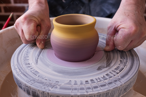 Potter wheel and hands of craftsman making a jug - Stock Photo - Images