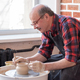 Senior male potter creating bowl in pottery workshop. Hobby at old age. - PhotoDune Item for Sale