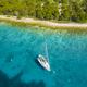 Yacht sailing near Kornati island archipelago at sunrise. Kornati National Park, Croatia - PhotoDune Item for Sale
