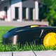 Robotic Lawn Mower cutting grass in the garden. - PhotoDune Item for Sale