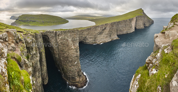 Dramatic atlantic rocky coastline cliffs landscape in Vagar. Faroe islands - Stock Photo - Images